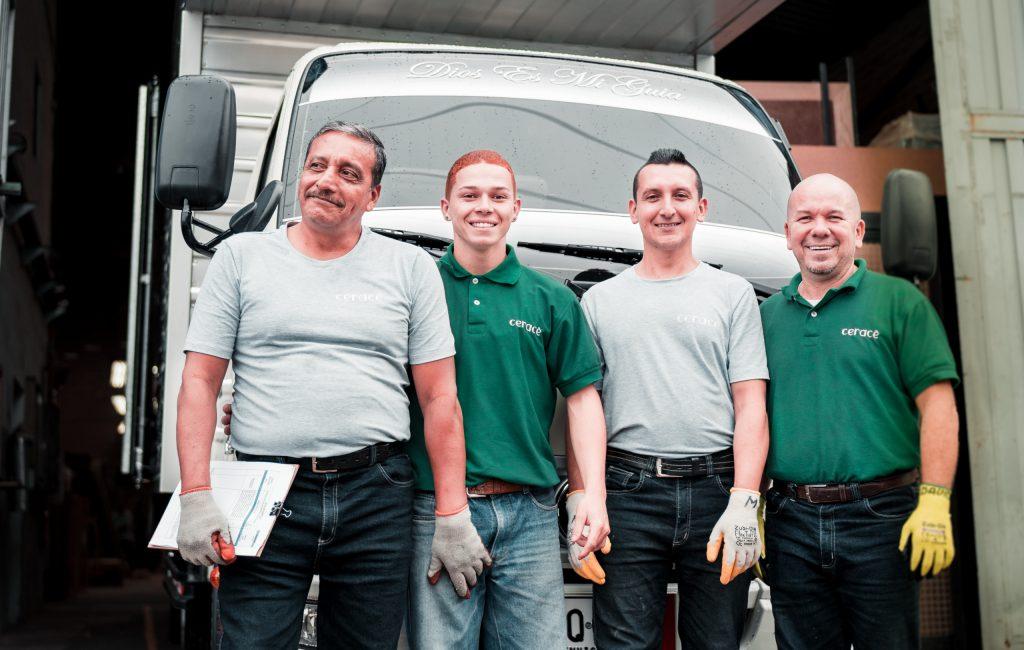 Canva - 4 Men Standing Near White Van